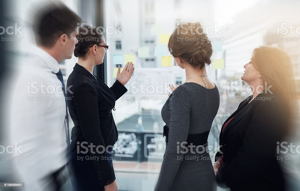 Analysing their approach from every angle stock photo