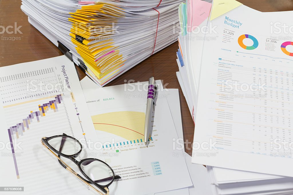 Analysis chart and paperwork on office table stock photo