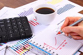 Analysis of sales plan, computer keyboard and cup of coffee