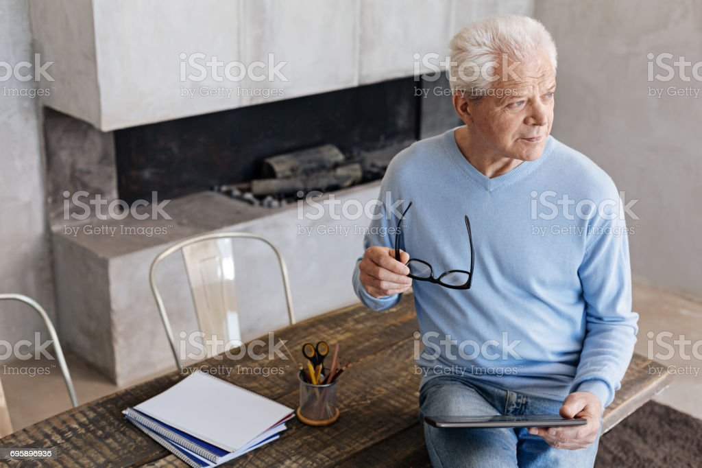 Analytical intelligent gentleman reading morning news stock photo