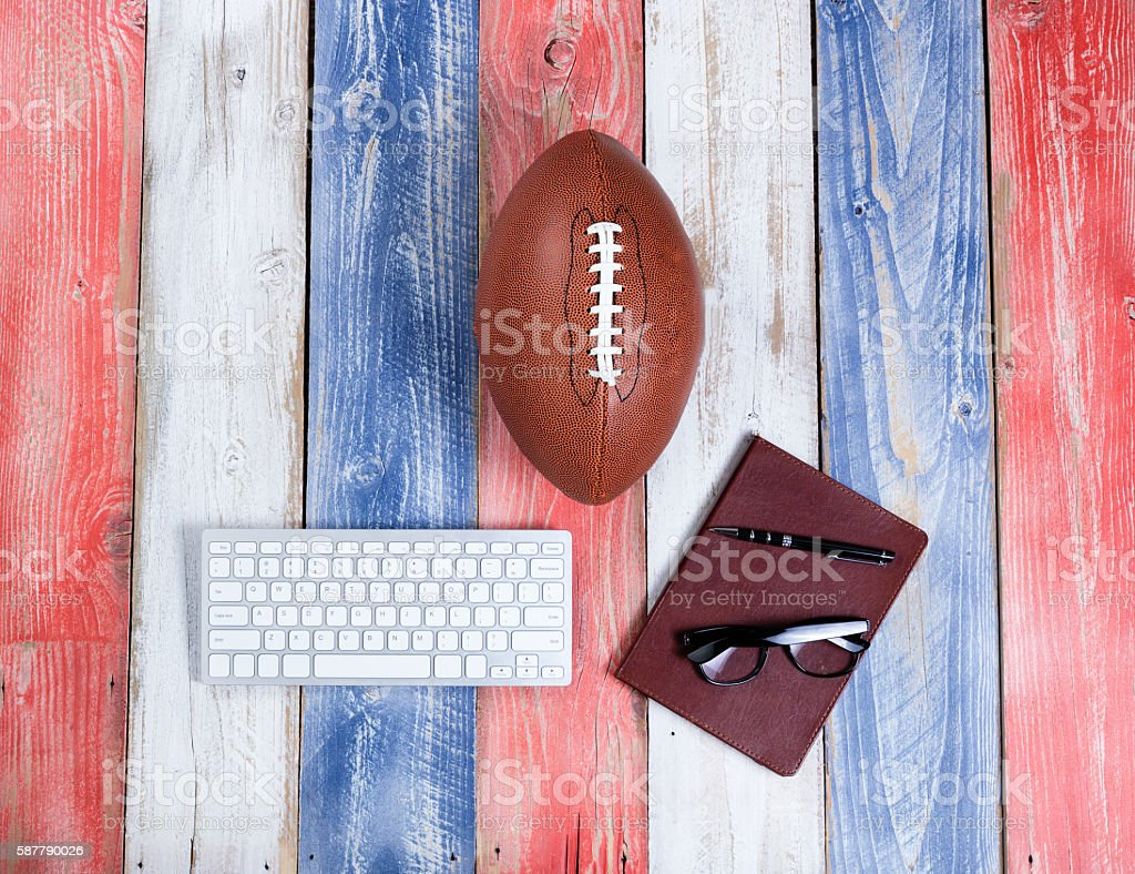 Analyzing American football for the season on rustic boards pain stock photo