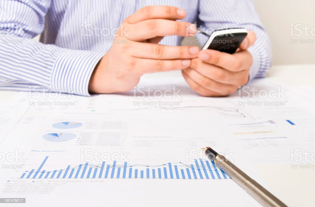 Analyzing and calculating financial data reports royalty-free stock photo