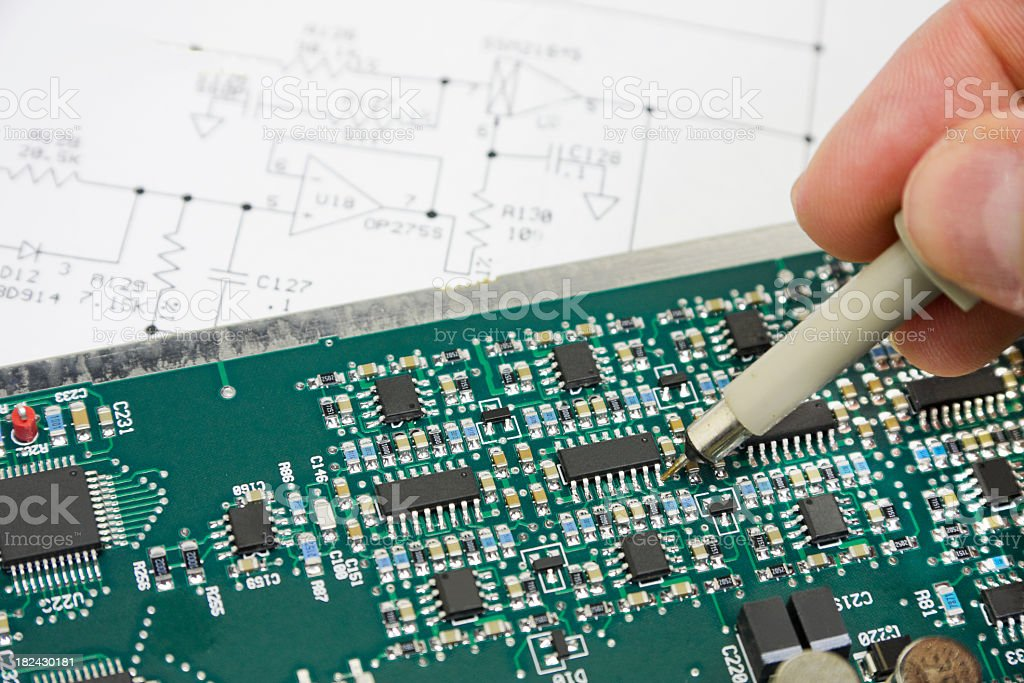 Analyzing and troubleshooting electronic circuit with a tool royalty-free stock photo