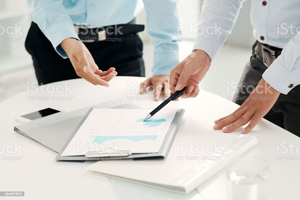 Analyzing business document stock photo