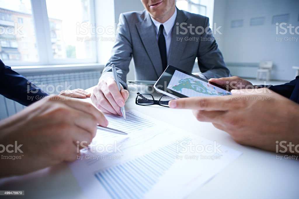 Analyzing charts stock photo