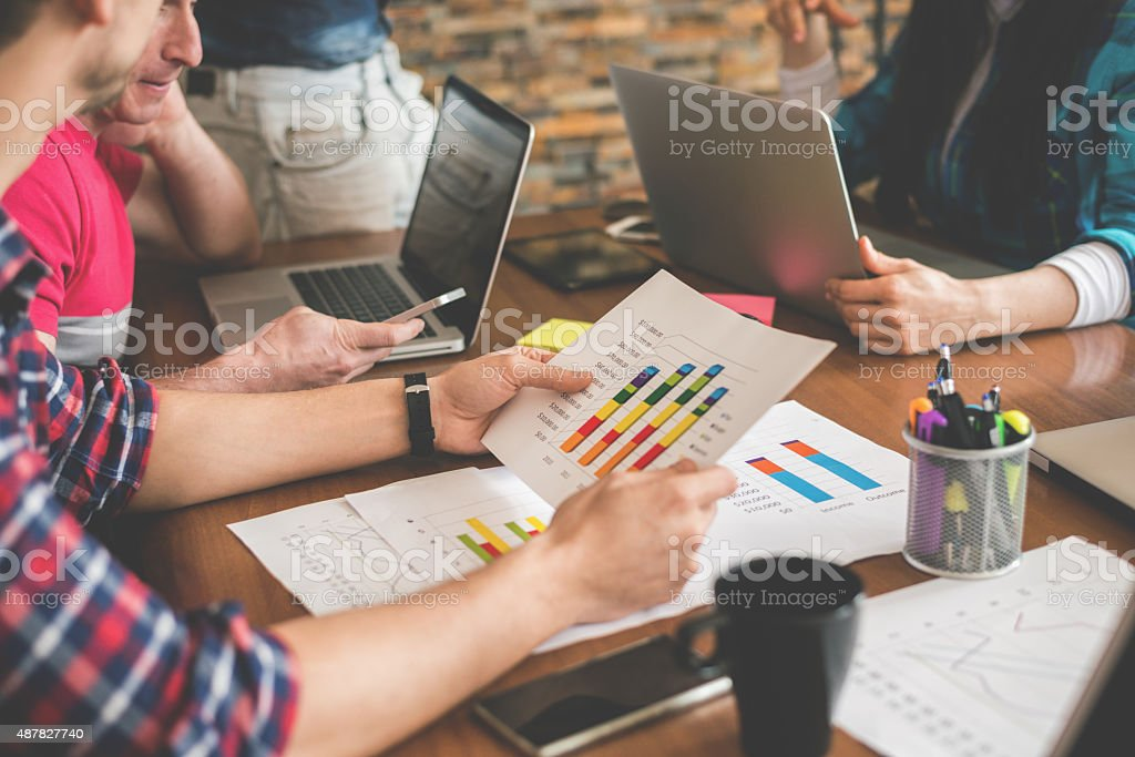 Analyzing data charts in the office stock photo