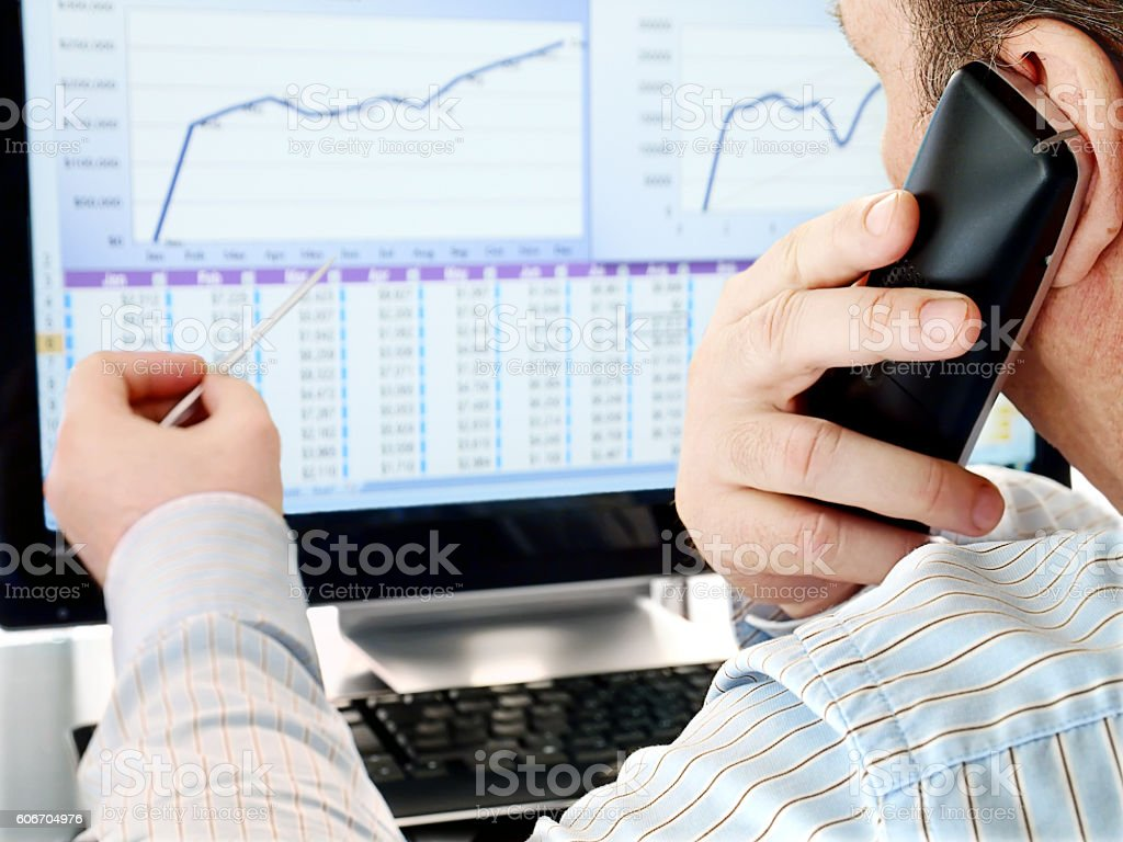 Analyzing Data on Computer stock photo