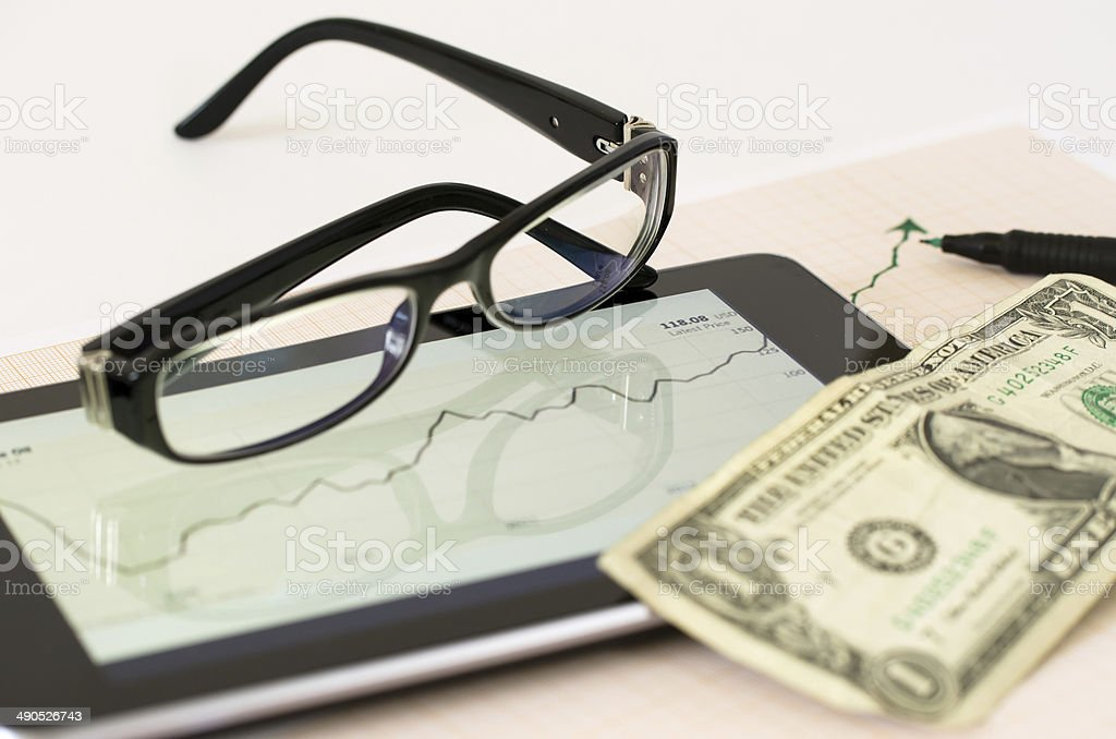 Analyzing data on tablet-pc royalty-free stock photo
