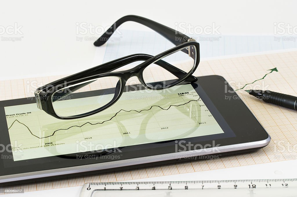 Analyzing data on tablet-pc stock photo