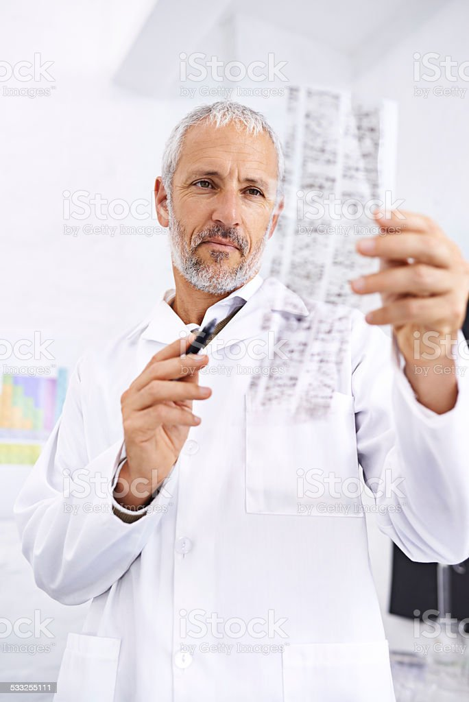 Analyzing DNA information stock photo