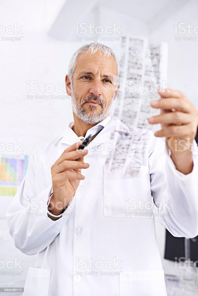 Analyzing DNA information stock photo