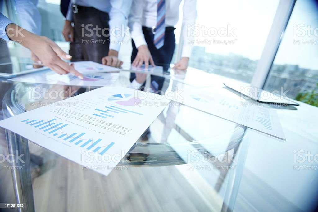 Analyzing documents stock photo