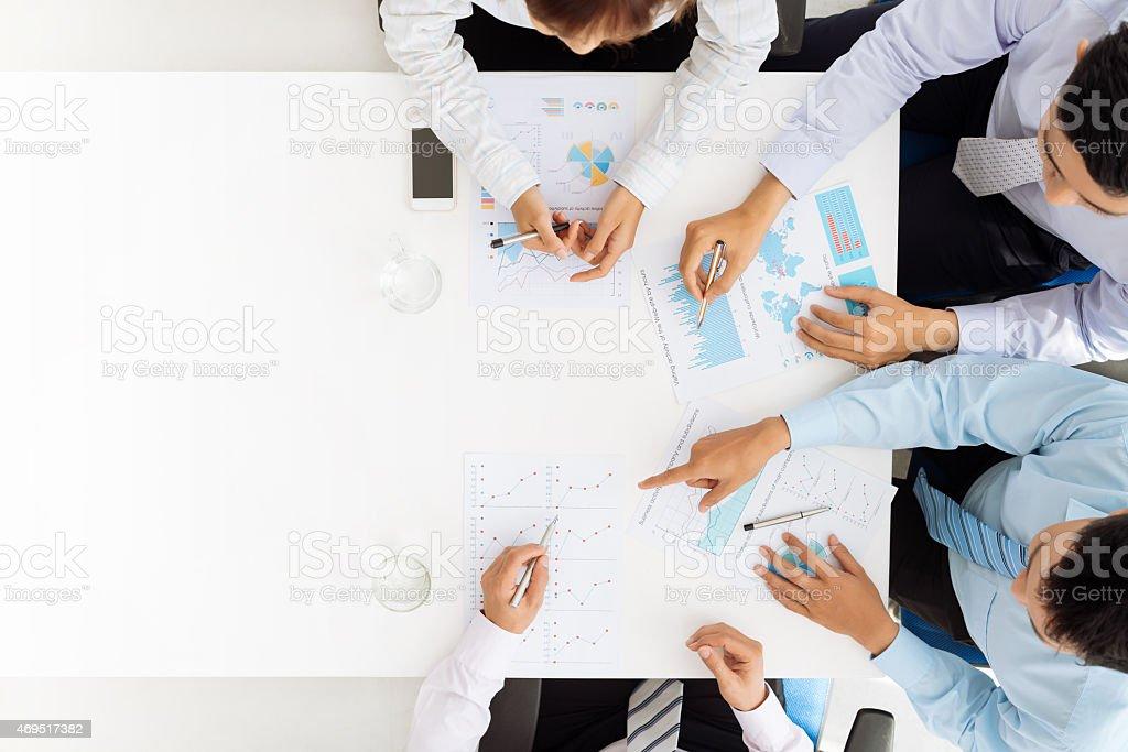 Analyzing financial documents stock photo