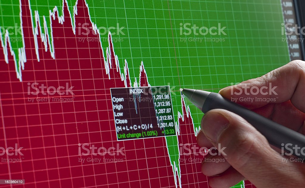 Analyzing financial market chart stock photo