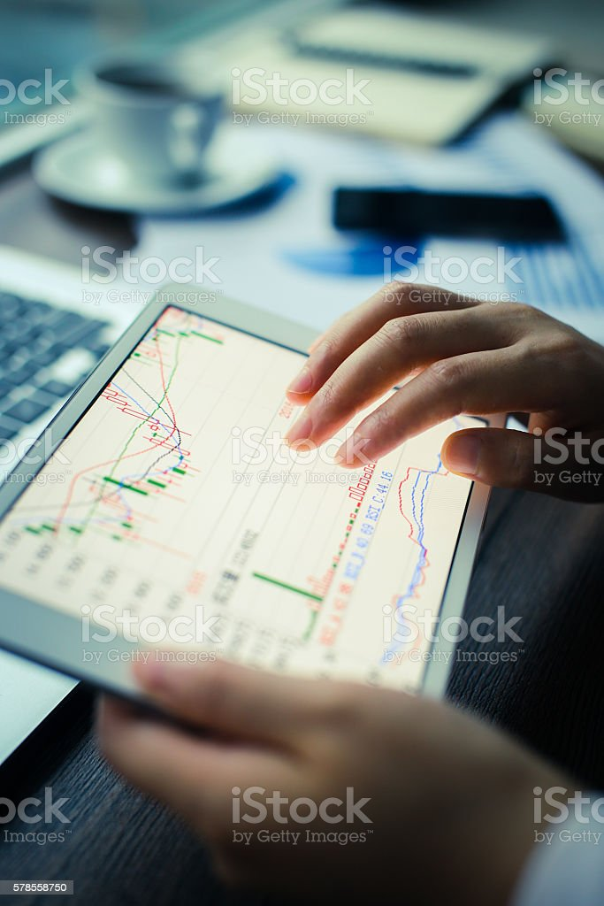 Analyzing Graph On Digital Tablet stock photo