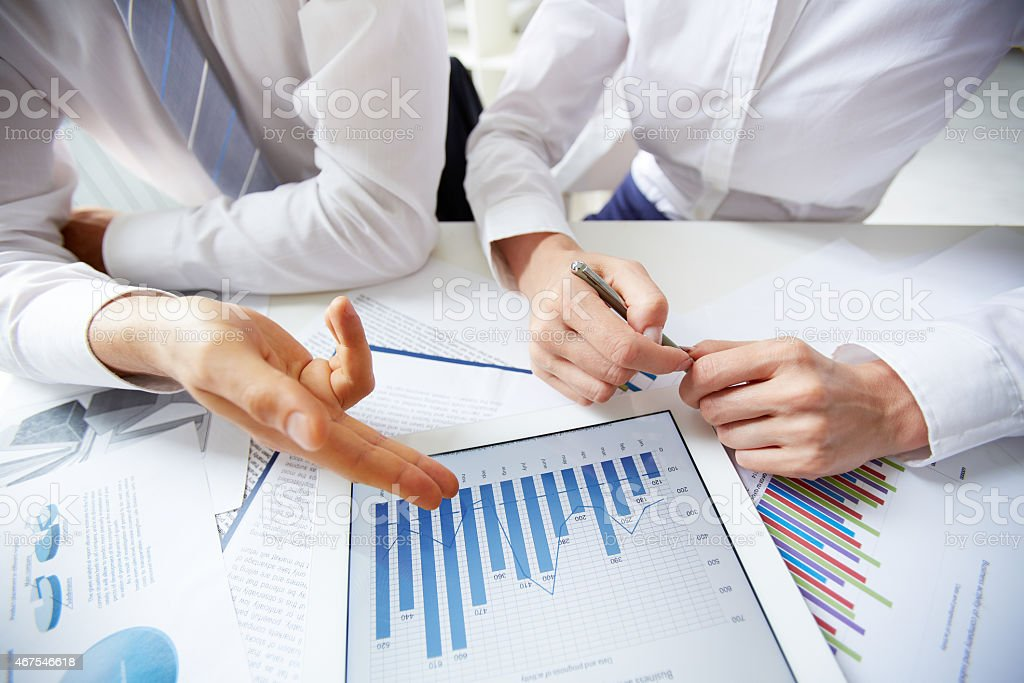 Analyzing graphs stock photo