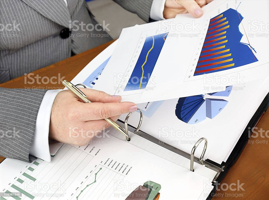 Analyzing Investment Charts royalty-free stock photo