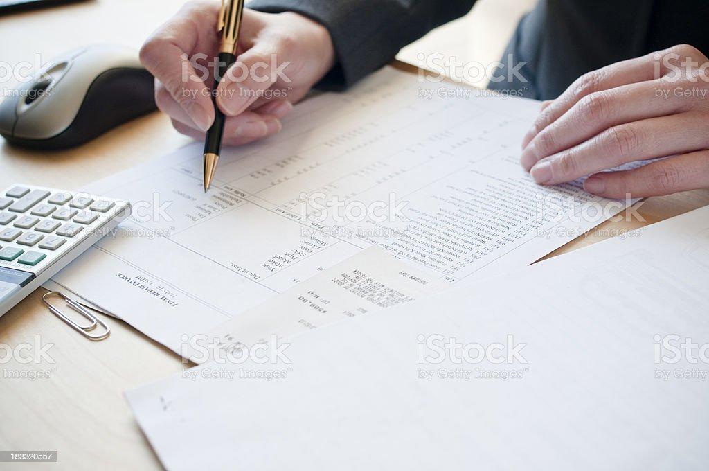 Analyzing invoice royalty-free stock photo