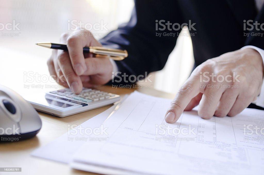 Analyzing invoice stock photo