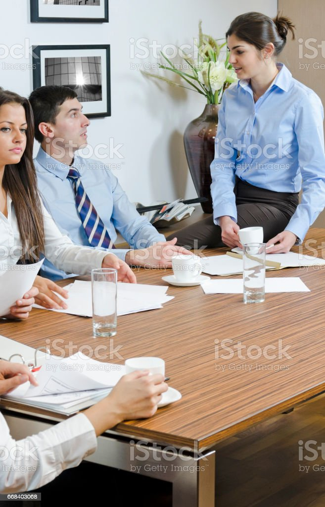 Analyzing paperwork and drinking coffee stock photo