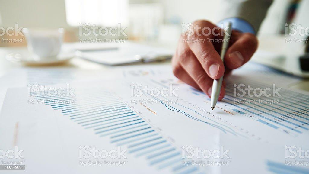 Analyzing profit growth stock photo
