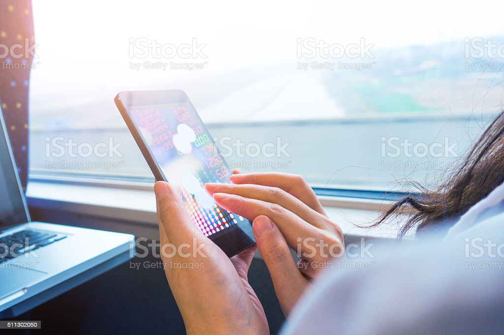 Analyzing stock market on mobile phone stock photo