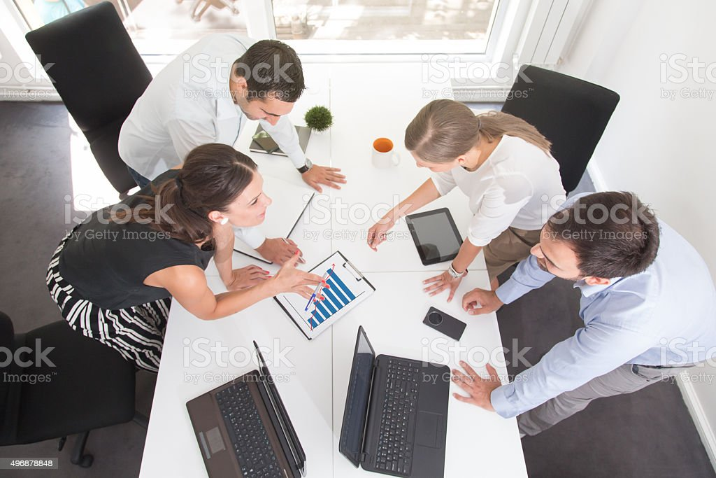 Analyzing The Day's Reports stock photo