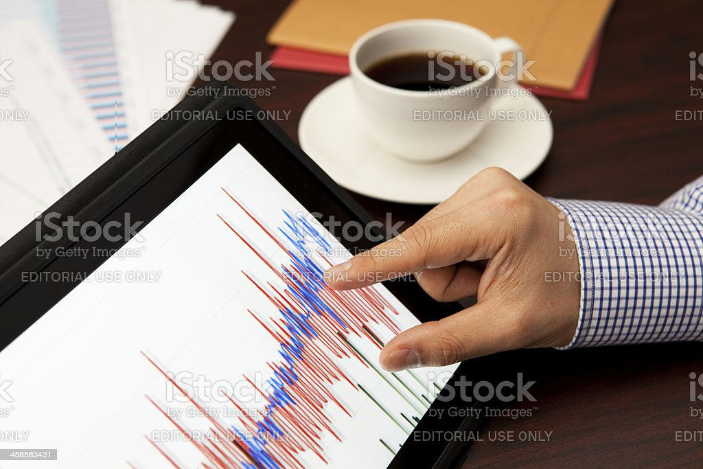 Analyzing with Digital Tablet(ipad) royalty-free stock photo