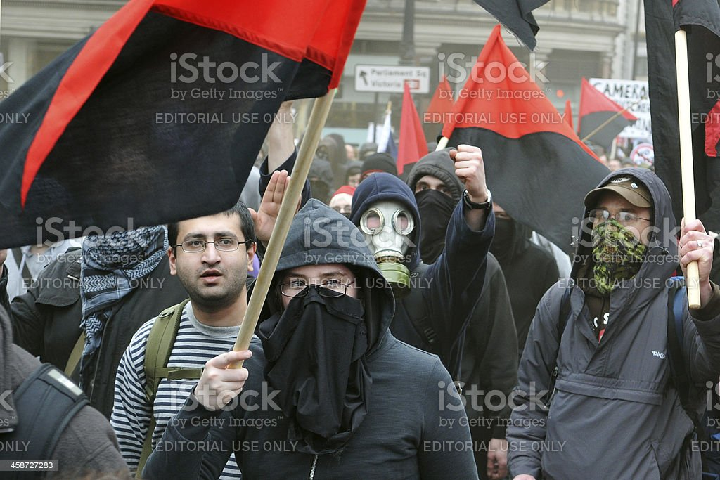 Anarchist Protesters March at an Austerity Rally in London stock photo