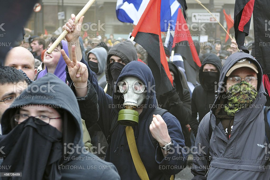 Anarchist Protesters March at Anti-Cuts Rally in London stock photo
