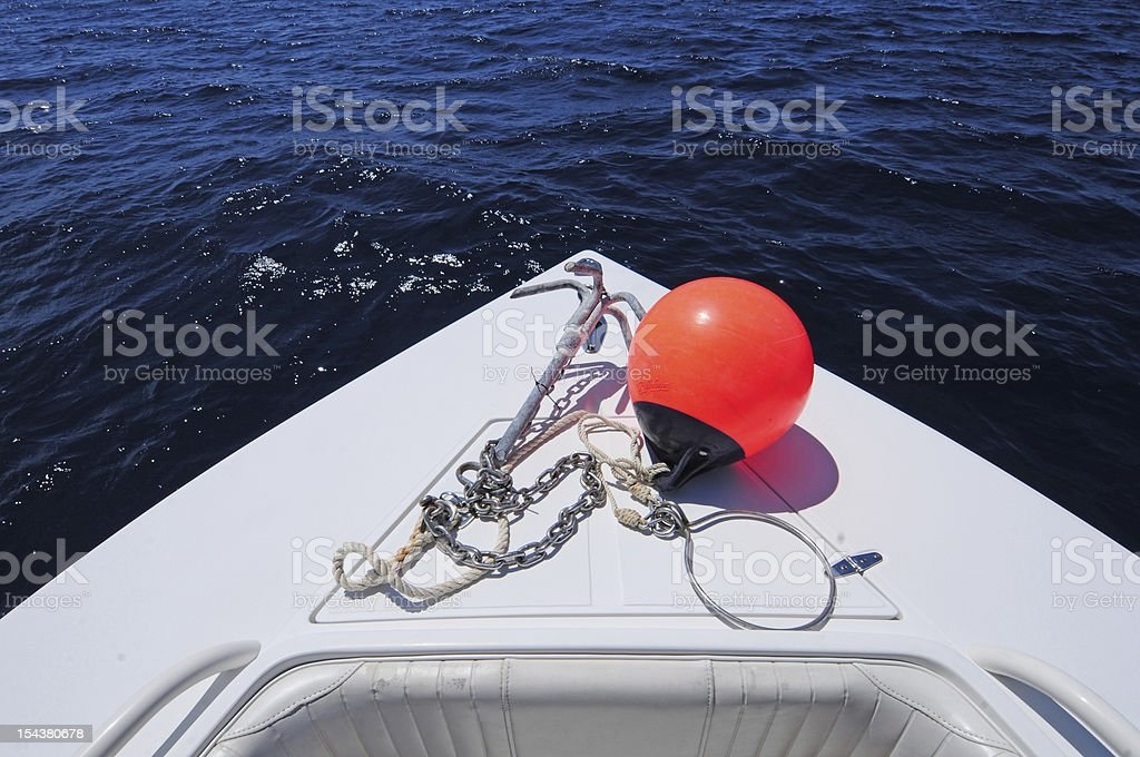 Anchor and buoy on the front of boat royalty-free stock photo