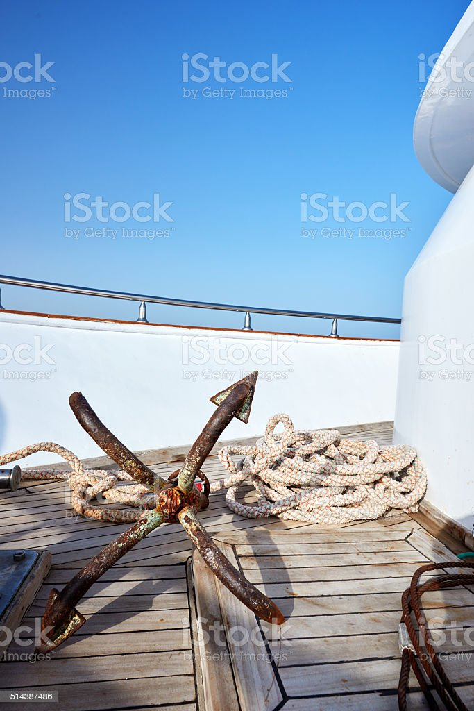anchor and rope on nautical vessel stock photo