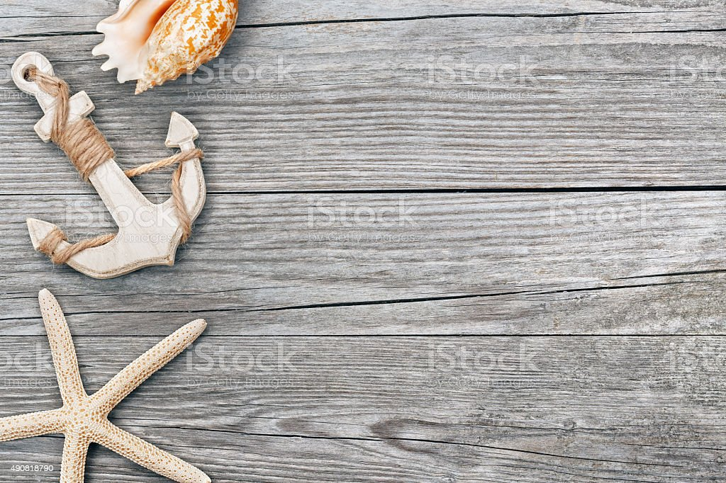 anchor and seashells on wooden background stock photo