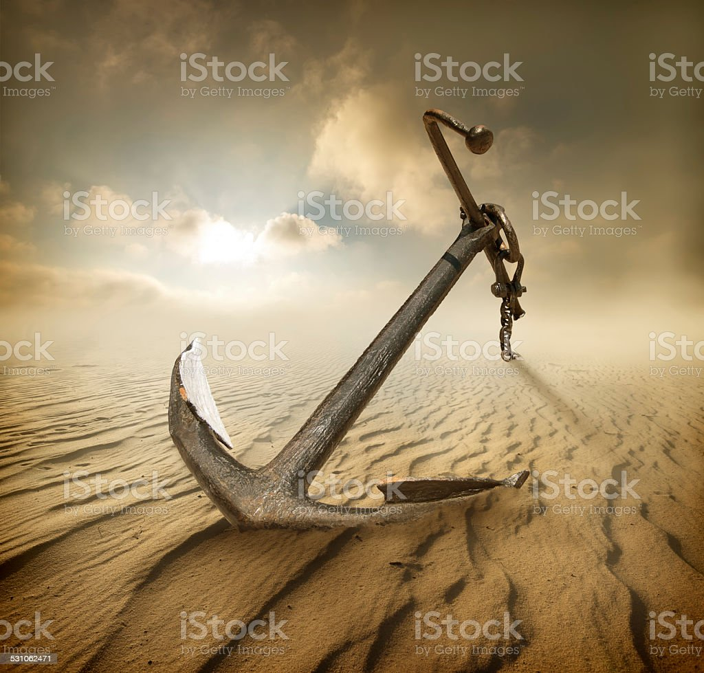 Anchor in desert stock photo
