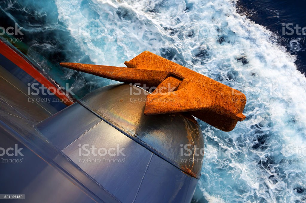 Anchor of a cargo vessel underway. stock photo