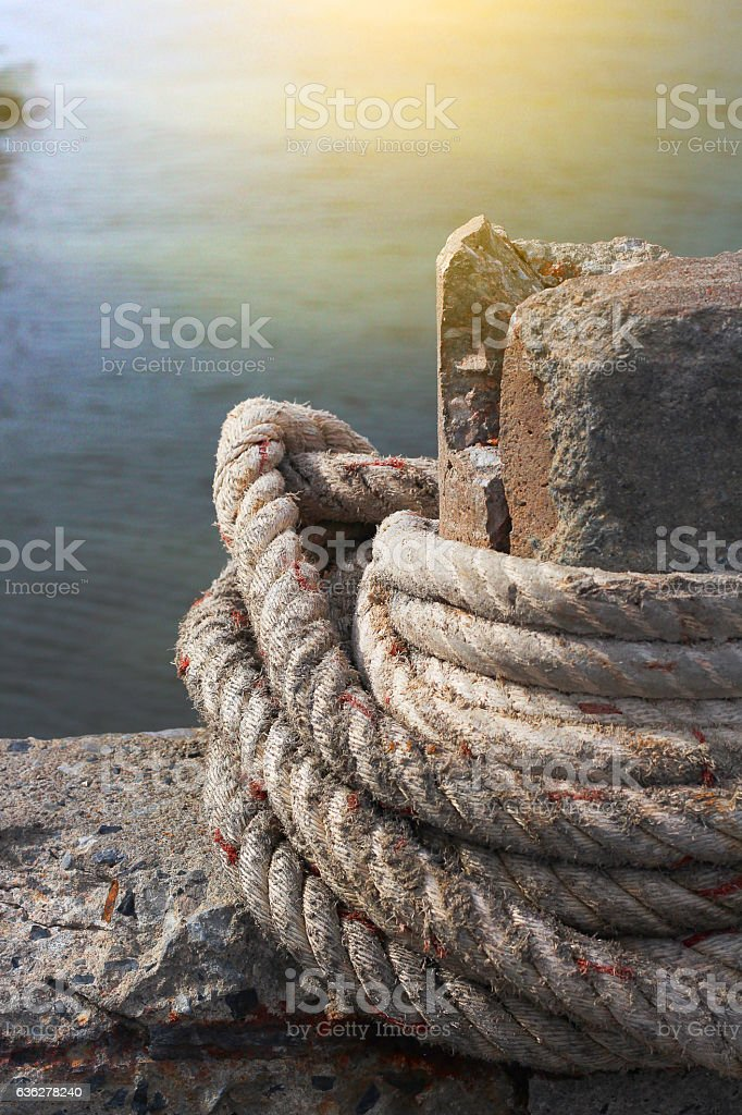 anchor rope tie up the stone pillar stock photo