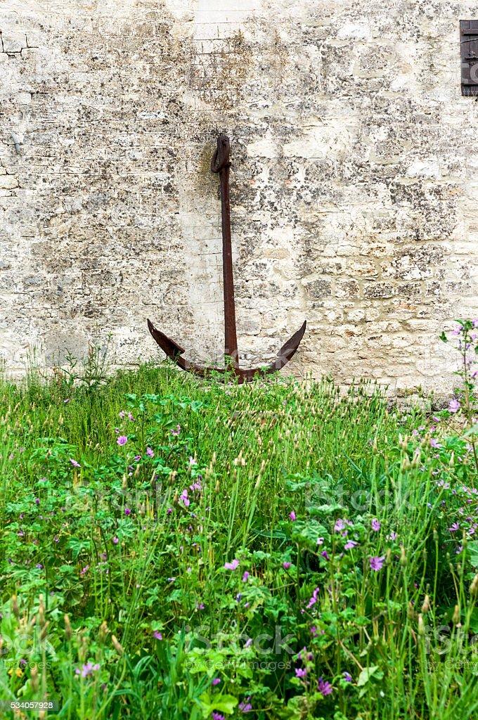 anchor, stone wall stock photo