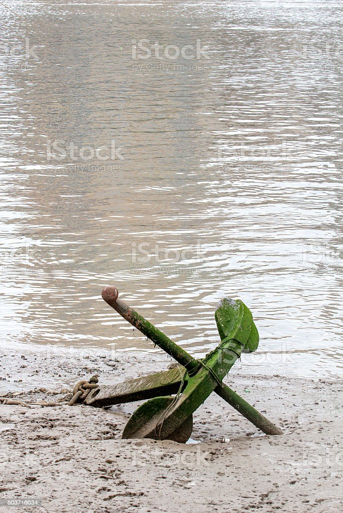 anchor stucked in muddy shoal stock photo