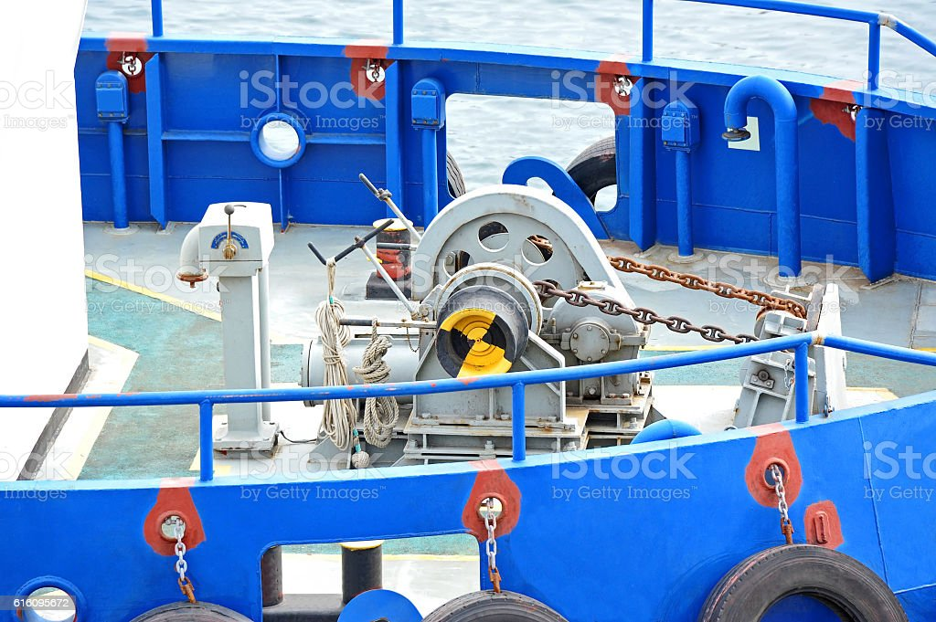 Anchor winch with chain stock photo