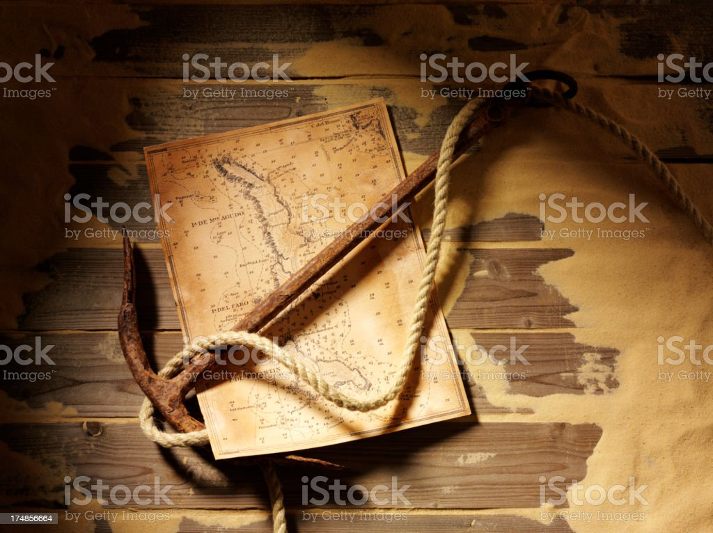 Anchor with a Treasure Map and Sand royalty-free stock photo