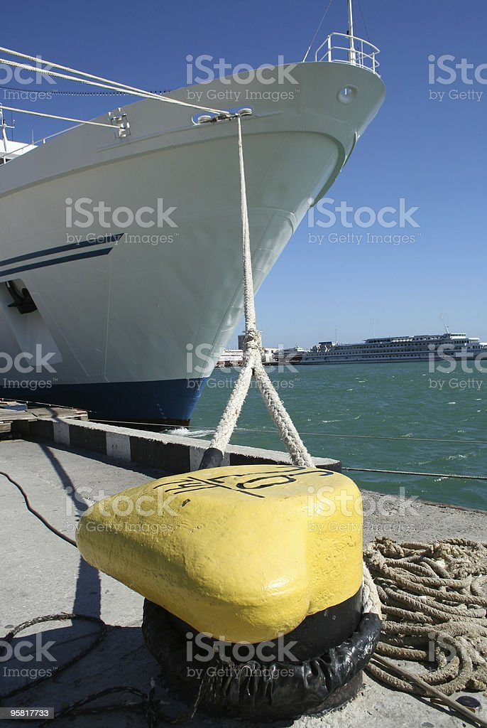 anchored by the rope royalty-free stock photo