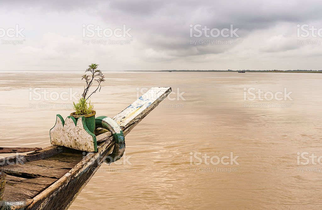 Anchored ferry following flood in monsoon on Brahmaputra river, India. stock photo
