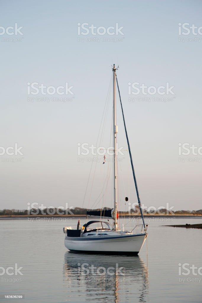 Anchored Yacht at Dusk royalty-free stock photo