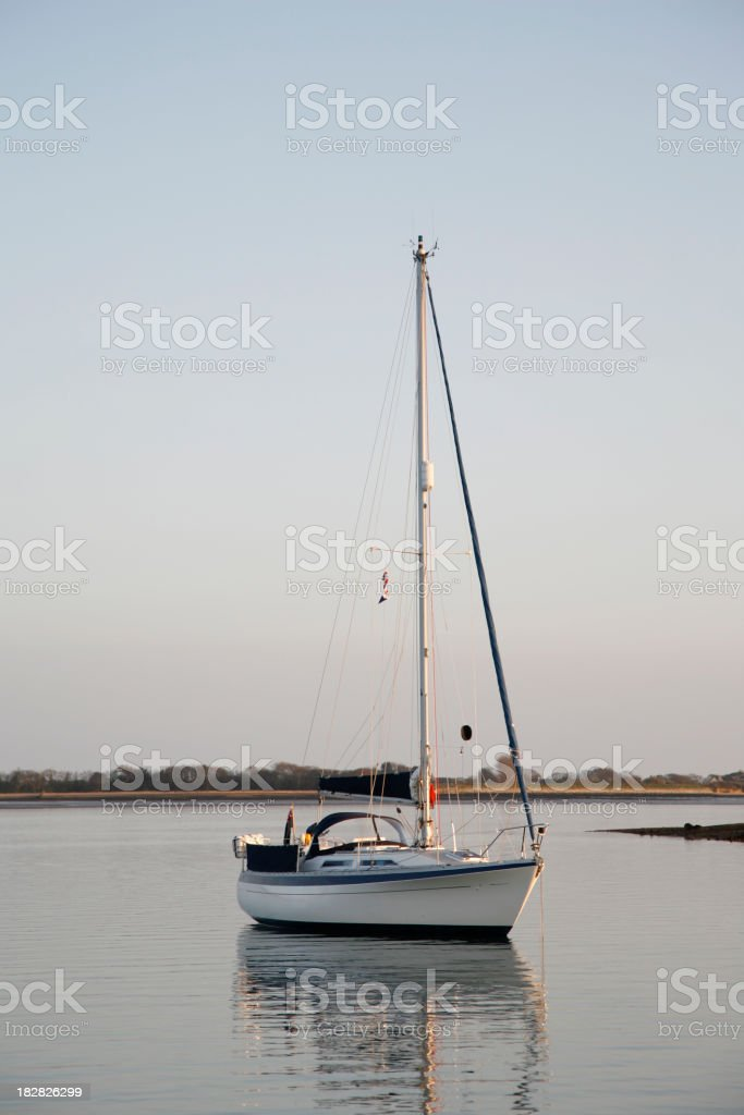 Anchored Yacht at Dusk stock photo