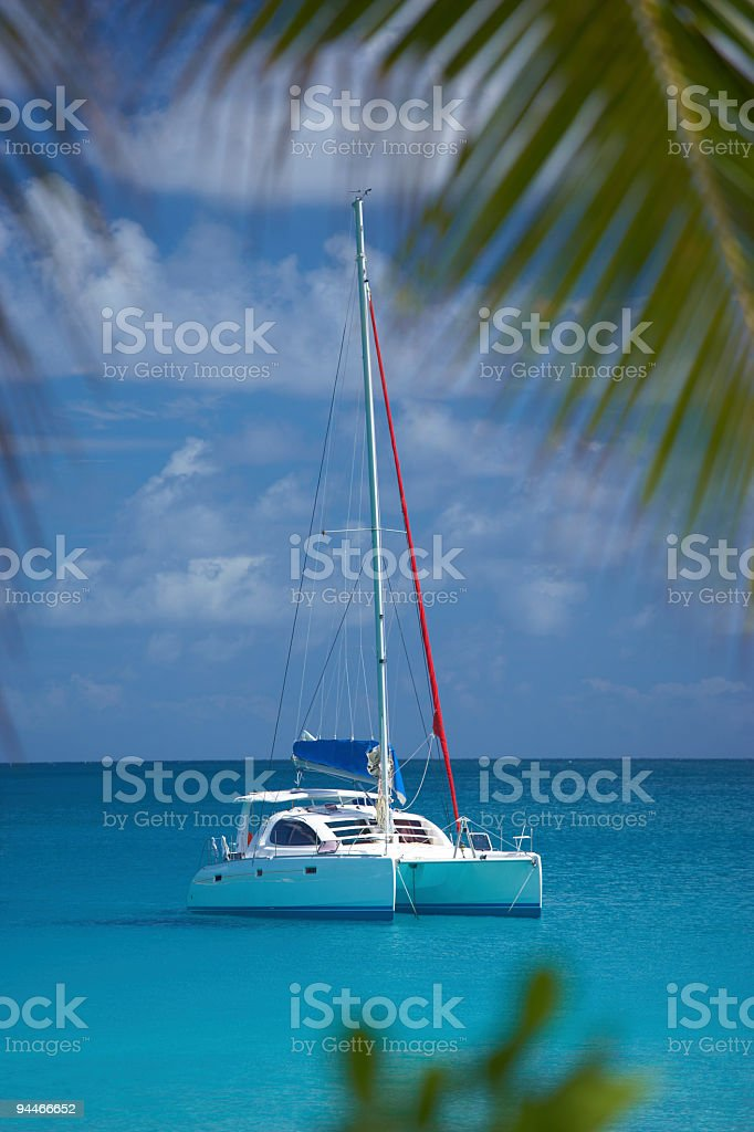 anchoring in lagoon of paradise stock photo
