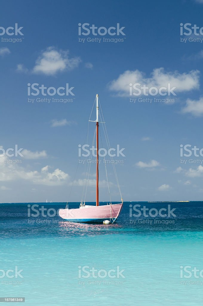 Anchoring pink boat in tropical bay stock photo