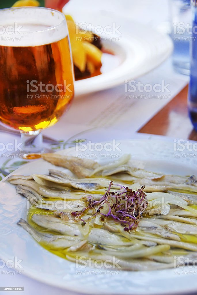 anchovies in vinegar and olive oil stock photo