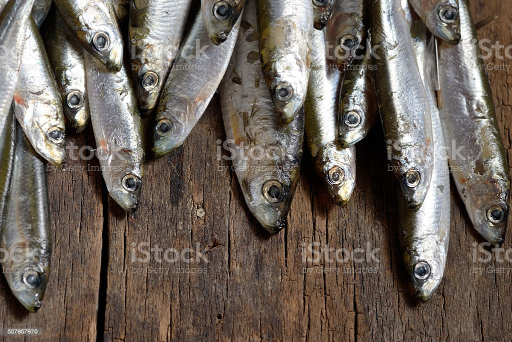 Anchovies (hamsi) on old table stock photo
