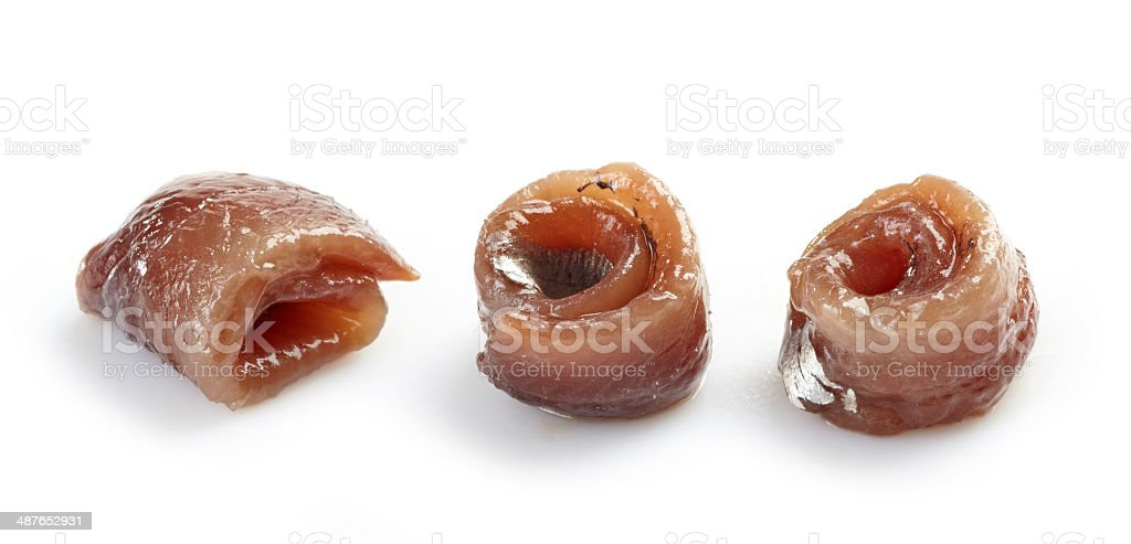 anchovies rolls on a white background stock photo