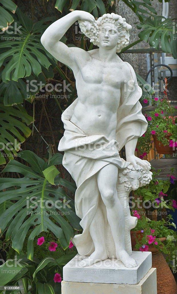 Ancien statue in the garden stock photo